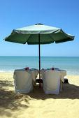 Restaurant on the beach with umbrella — Stock Photo