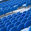 Blue chairs of the stadium — Stock Photo