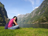 Woman relaxing in the fjord of Gudvangen — Stock Photo