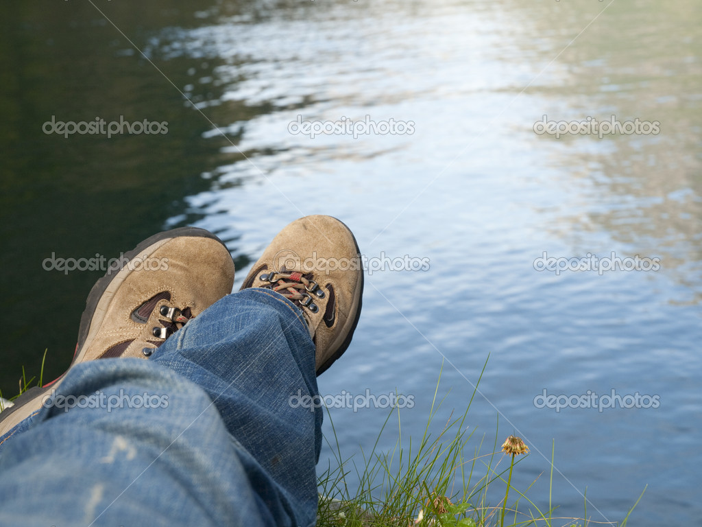 Man relaxing in a fjord shore  Stock Photo #3174763
