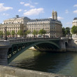Green bridge over the Seine river - Stock Photo