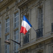 French flag in a Paris building — Stock Photo