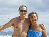 Senior Couple having fun in the beach — Stock Photo