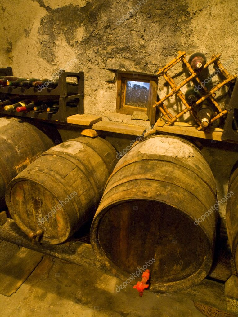 Old cellar with some grunge wine barrels — Stock Photo #3194089