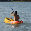 Kayaking in the lake - Stock Photo