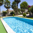 Large Swimming Pool in a holiday villa — Stock Photo