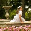 Girl posing with her first communion dress — Stock Photo