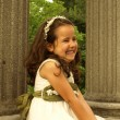 Stock Photo: Girl posing with her first communion dress