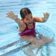 Girl playing in the pool — Stock Photo