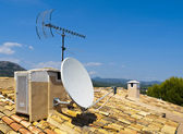 Antenna on a Tile Roof — Stock Photo