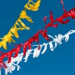 Stock Photo: Celebratory colour tapes on a carnival, garlands.