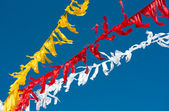 Celebratory colour tapes on a carnival, garlands. — Stock Photo