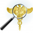 Caduceus under magnifying glass — Stock Vector
