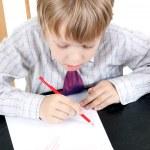 The boy draws — Stock Photo #3303306