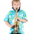 Boy plays a saxophone — Stock Photo