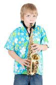 Boy plays a saxophone — Stock Photo