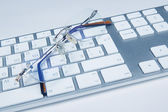 Keyboard with glasses colored — Stock Photo