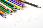 Color pencils with picture — Stock Photo