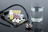 Tablets and water — Stock Photo