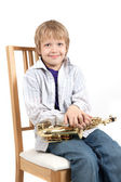 Boy sit on a chair — Stock Photo