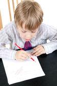 The boy draws — Stock Photo