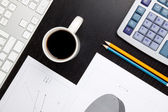 Office desk with calculator — Stock Photo