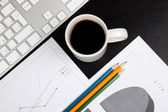 Office desk with coffee — Stock Photo
