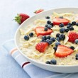 Oatmeal breakfast cereal with berries — Stock Photo