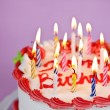 Birthday cake with lit candles - Foto Stock