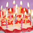 Birthday cake with lit candles - Stockfoto