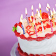 Birthday cake with lit candles — Stock Photo #4466654