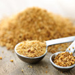 Coconut palm sugar in measuring spoons - Stock Photo