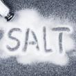 Salt spilled from shaker — Stock Photo