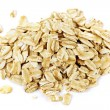 Pile of uncooked rolled oats - Stock Photo