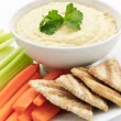 Hummus with pita bread and vegetables — Stock Photo #4467649