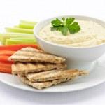 Постер, плакат: Hummus with pita bread and vegetables