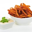 Sweet potato fries with sauce — Stock Photo