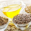 Stock Photo: Flax seeds and linseed oil