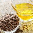 Brown flax seed and linseed oil — Stock Photo