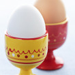 Boiled eggs in cups — Stock Photo