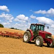 Tractor in plowed field - Stockfoto