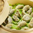 Bamboo steamer with dumplings — Stock Photo #4468511