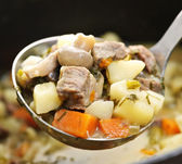 Beef stew in serving spoon — Stock Photo