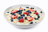 Bowl of oatmeal with berries — Stock Photo