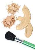 Powder and foundation makeup with brush — Stock Photo