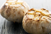 Roasted garlic bulbs — Stock Photo