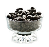 Bowl of chocolate coated cranberries or raisins — Stock Photo