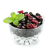 Bowl of chocolate coated cranberries — Stock Photo