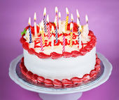 Birthday cake with lit candles — Stock Photo
