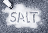 Salt spilled from shaker — Stock Photo